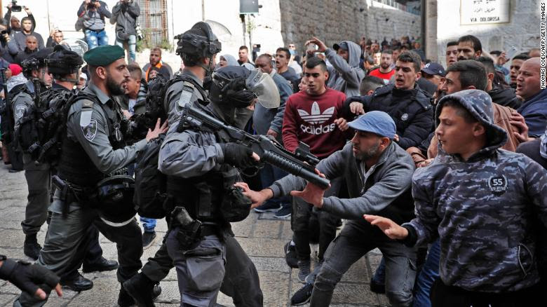 Israeli forces confront Palestinian protesters in Jerusalem's Old City on Friday.
