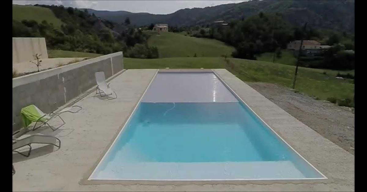 Volet roulant pour piscine immerge for Piscine miroir et volet roulant