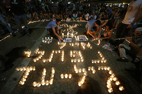 Names of murdered teens in candles (Photo: Yaron Brenner)