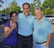In this photo released on Wednesday Oct. 12, 2011 by the state media Cubadebate website, convicted Cuban agent Rene Gonzalez poses for a photo with youngest daughter Ivette, and his father Candido at an undisclosed location, Friday Oct. 7, 2011. The United States offered to let Rene Gonzalez return home in exchange for the release of an imprisoned American Alan Gross, but Cuba rebuffed the offer, U.S. officials said. The U.S. also indicated it would be willing to address other Cuban grievances after Havana released imprisoned contractor Gross, according to the officials, who spoke to The Associated Press on condition of anonymity because the sensitivity of the issue. (AP Photo/Cubadebate)