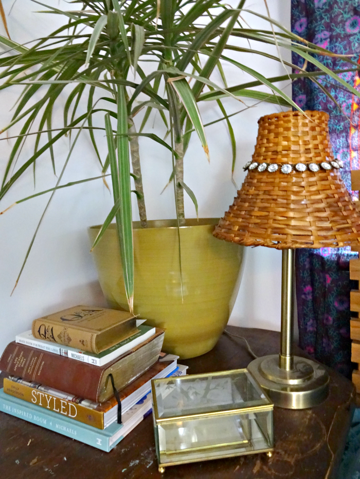 large nightstand for lots of books and a big plant