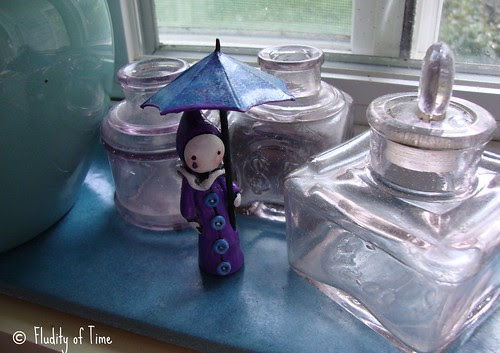 poppet with glass.jpg