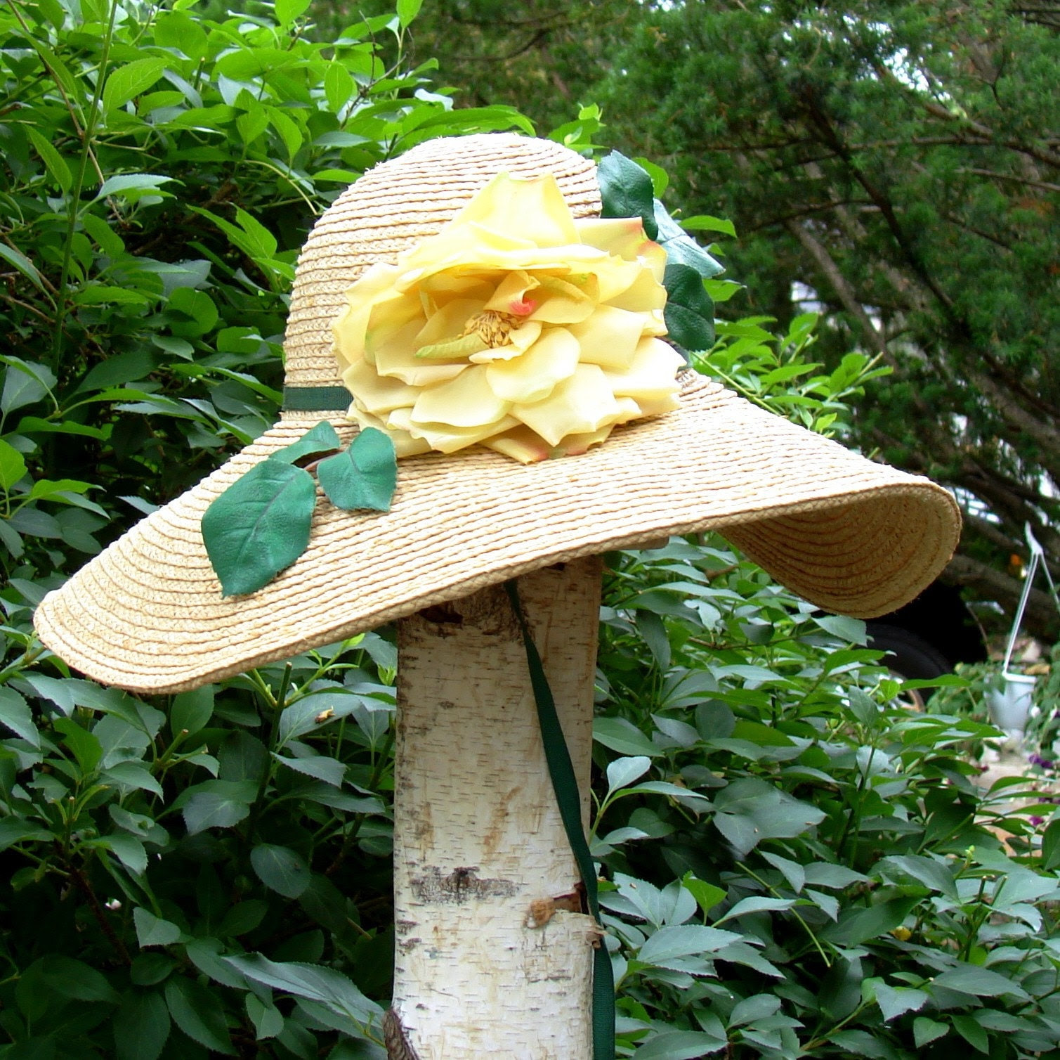 STRAW SUN HAT WITH YELLOW ROSE AND CARVED JADE NECK PULL BEAD