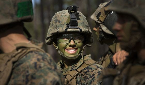 Pfc. Christina Fuentes Montenegro and other Marines from Delta Company, Infantry Training Battalion, School of Infantry-East, receive final instructions prior to assaulting an objective during the Infantry Integrated Field Training Exercise aboard Camp Geiger, N.C., Nov 15, 2013. (U.S. Marine Corps photo)
