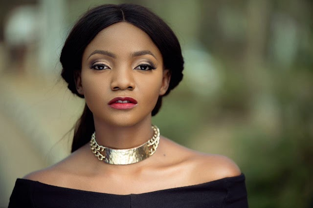 Singer Simi has revealed that she once had a gun pointed at her and her friends by a police officer simply because one of them laughed.