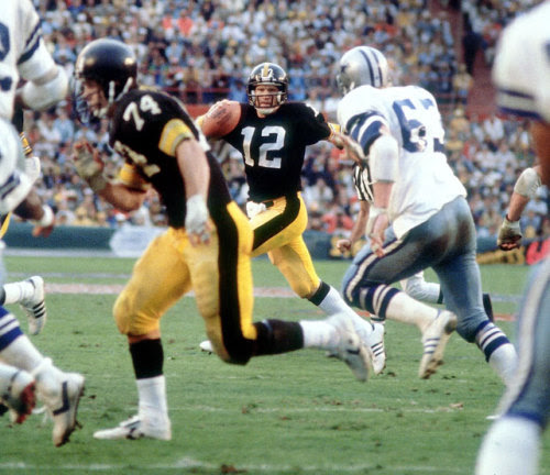 Steelers quarterback Terry Bradshaw scrambles before throwing one of his four touchdown passes in Super Bowl XIII at the Orange Bowl in Miami on Jan. 21, 1979. Pittsburgh defeated the Dallas Cowboys 35-31 to become the first team to win three Super Bowls. (Walter Iooss Jr./SI)