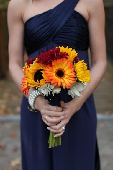 I love the bouquet, but also the navy blue dress.