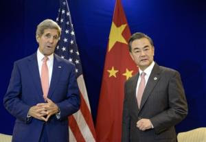 China's Foreign Minister Wang Yi, right, listens while U.S. Secretary of State John Kerry talks before a bilateral meeting at the Putra World Trade Center in Kuala Lumpur, Malaysia Wednesday, Aug. 5, 2015. (Brendan Smialowski/Pool Photo via AP)