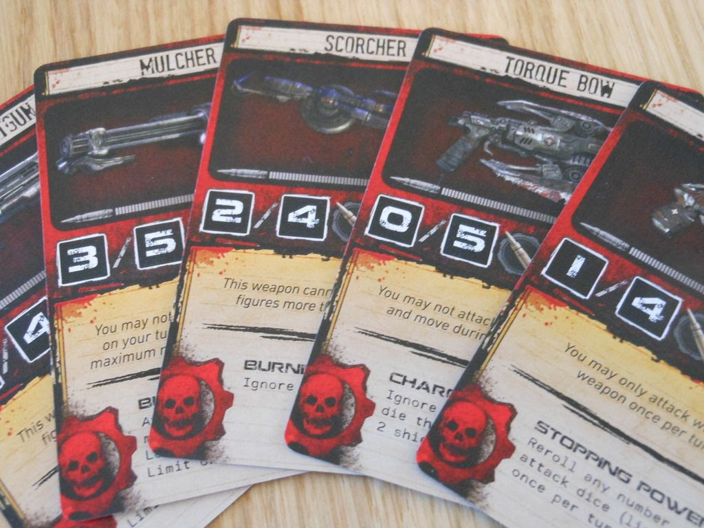 An arrangement of weapon cards from Gears of War, depicting iconic weapons such as the torque bow.