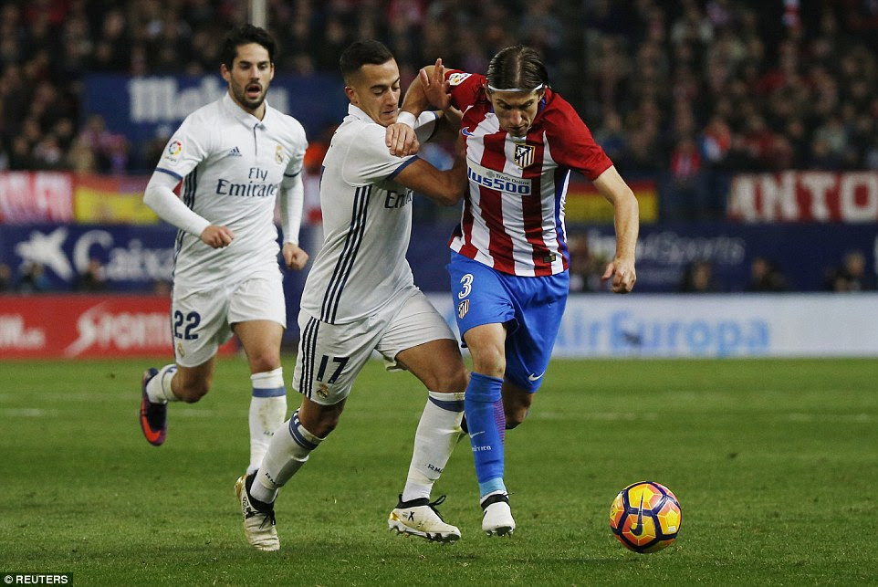 Filipe Luis bears down the pitch as Real Madrid's Lucas Vasquez grapples with the rampaging Atletico Madrid defender