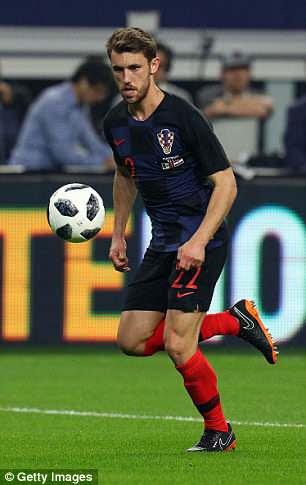 Luka Modric models Croatia's new home kit while Josip Pivaric wears the away kit