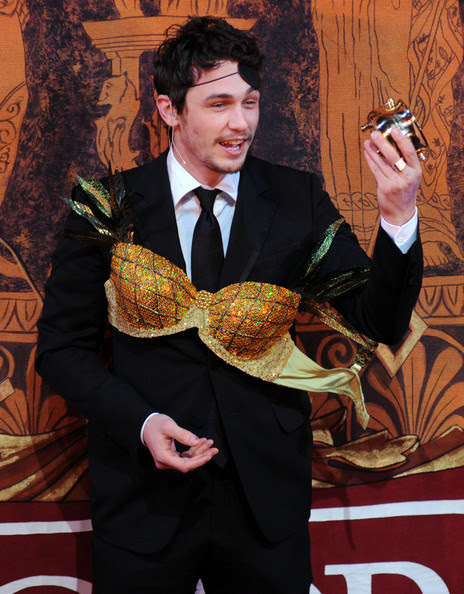 Actor James Franco holds the Hasty Pudding Pot award Harvard University
