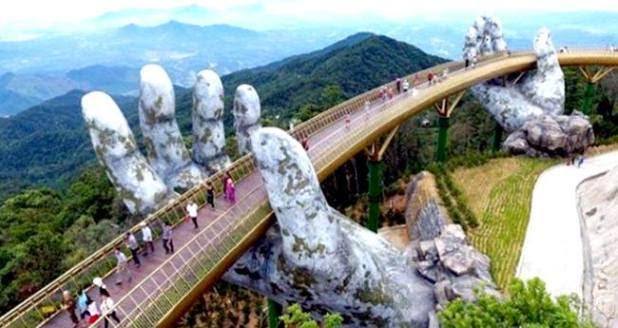 Golden Bridge Cau Vang in Vietnam held up by enormous structure of two hand