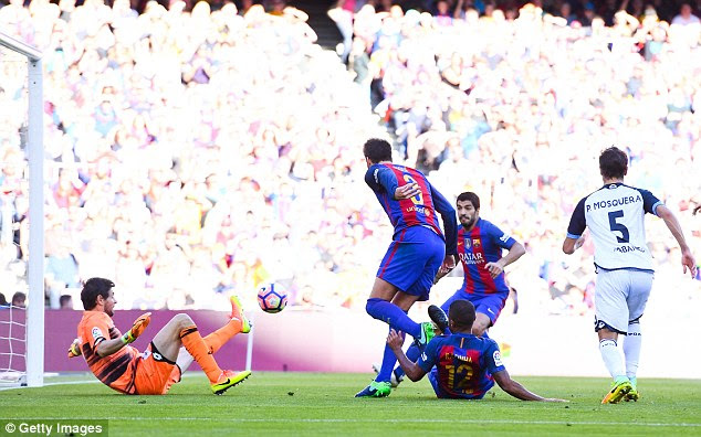 Rafinha bundles in from close range to make it 2-0 to Barca in the 36th minute