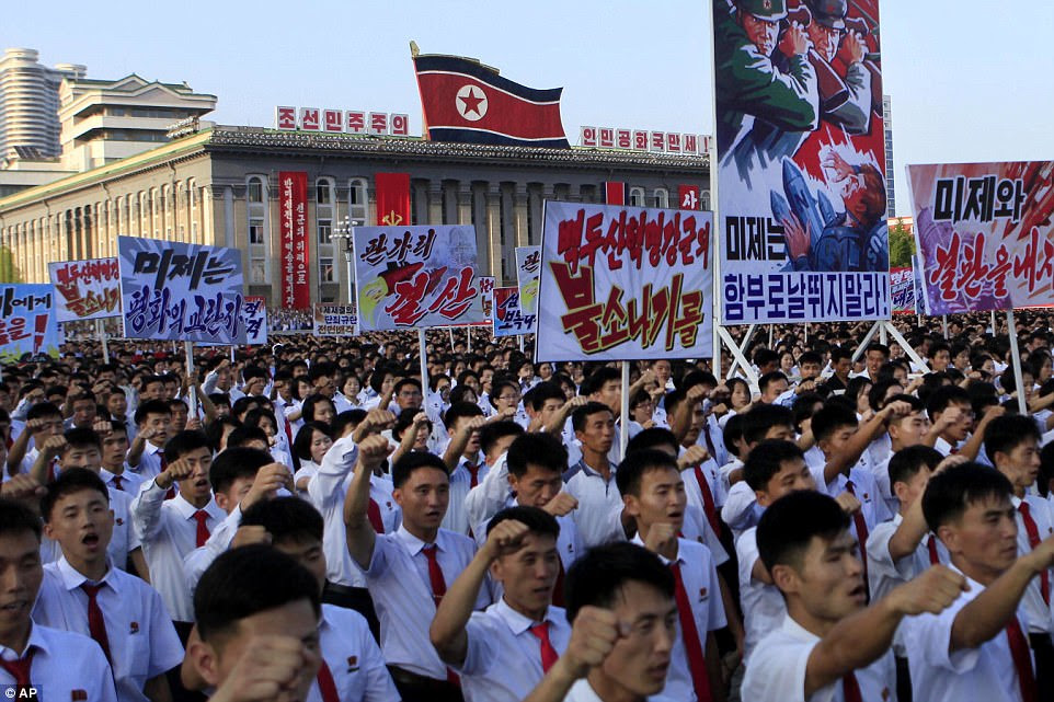 Tens of thousands of North Koreans gathered for a rally at Kim Il Sung Square today carrying placards and propaganda slogans as a show of support for their rejection of the United Nations' latest round of sanctions