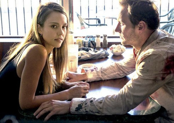 Jessica Alba (as Charlie) and Patrick Wilson (as Stretch) in a production still from STRETCH.