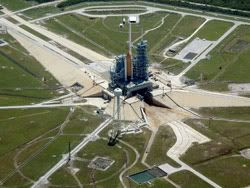 The Space Shuttle Discovery lies atop its pad at Launch Complex 39B at Kennedy Space Center in Florida.