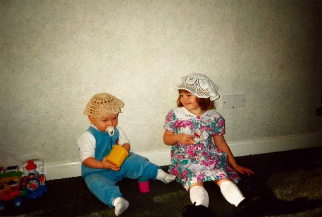 My brother and I with doilies on our heads