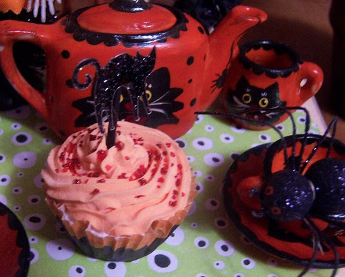 a witches teaparty with poisoned baked goods