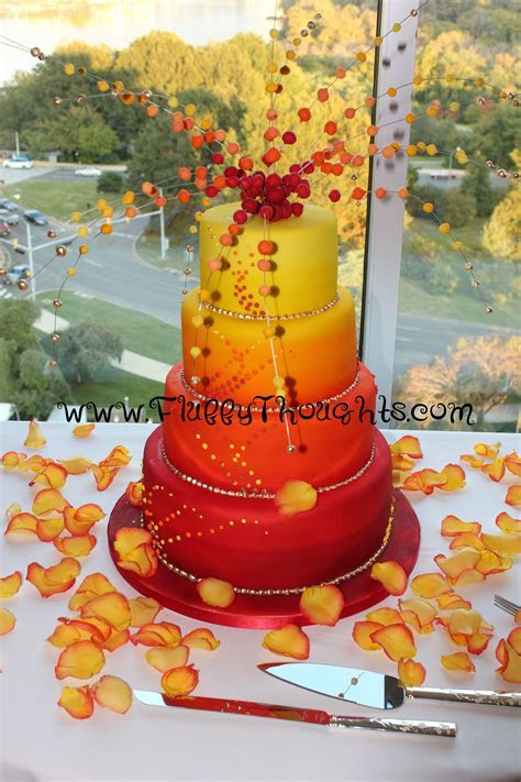 red and yellow wedding cake explosion! by Fluffy Thoughts