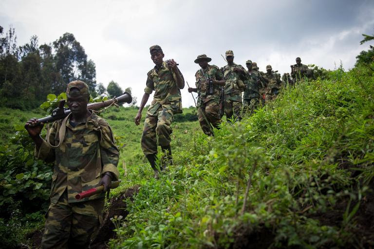 M23 rebels withdraw through the hills having left their position in the village of Karuba, eastern Democratic Republic of Congo, on November 30, 2012