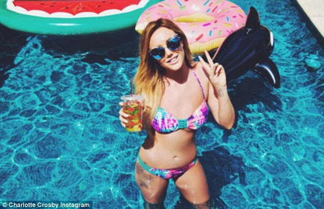 Water load of fun!Wearing one of her own designs, the Geordie Shore star sizzled in the skimpy bikini, which bore a colourful pink and blue design and faunted her toned stomach