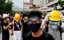 Police clashes as Hong Kong protest sweeps into neighbourhood popular with Chinese shoppers