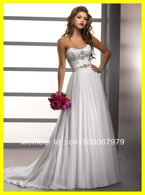White and silver wedding dresses   Luxury Brides