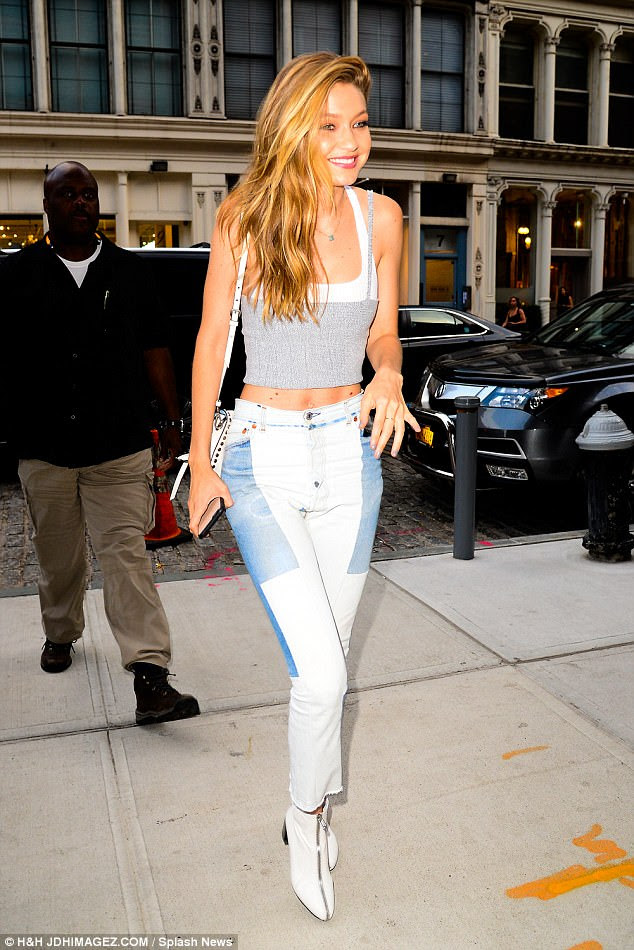 Svelte:The model, 22, looked truly radiant as she returned to her apartment from a photo shoot in quirky jeans and a skimpy crop top - leaving her enviably slender figure  on show