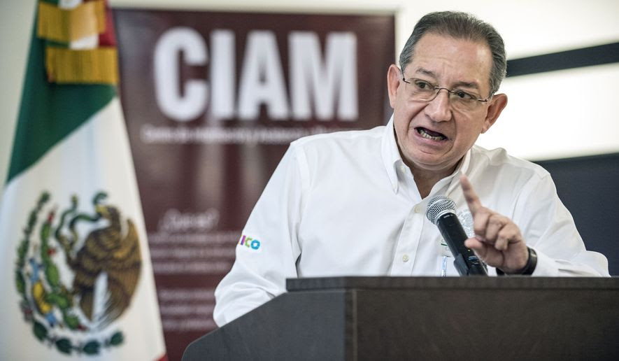 Mario Cuevas Zamora, head counsel for the Consulate of Mexico in Santa Ana, announces the launching of a center of legal defense, a booth for immigrants to drop in and get help with immigration questions, Friday, March 3, 2017, in Santa Ana, Calif. The centers will be in consulates nationwide and will open beginning Monday. (Mark Rightmire/The Orange County Register via AP)