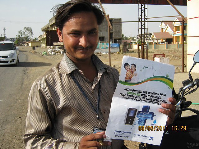 Shivraj Gavali (8055590595) of Eureka Forbes, with the flyer of  Aquaguard Total Riviva, Price Rs. 10,990, must in every home in Wagholi Pune