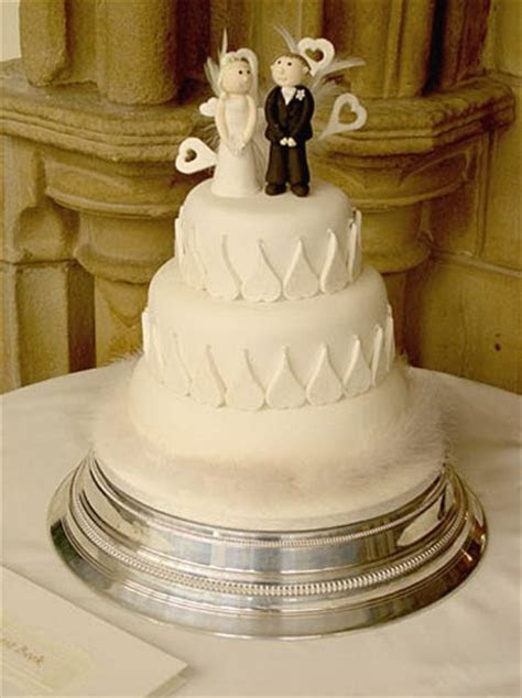 hearts wedding cake with bride and groom top