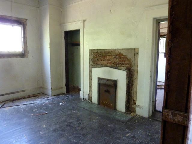 P1170747-2013-03-19--1148-North-Highland -VaHi-Teardown-before-North-Unit-B-Bedroom-fireplace-door-to-living-room