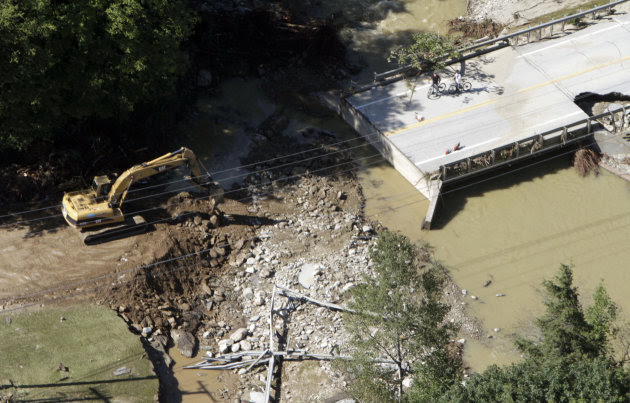 A bridge is out on Route 100 in this aerial view on Tuesday, Aug. 30, 2011 in Ludlow, Vt.   National Guard helicopters rushed food and water Tuesday to a dozen Vermont towns cut off by flooding from t