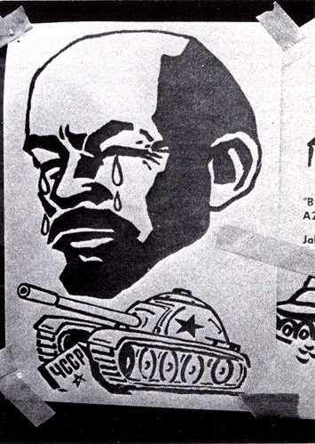 a Czech propaganda poster on a wall in Prague,  Czechoslovakia in 1968 showing a Soviet tank driving over a marker labeled 4CCP/ЧССР/CSSR/Czechoslovak Socialist Republic and a disembodied, jug-eared crybabyLenin cries his poor little eyes out with giant tears streaming down his face.