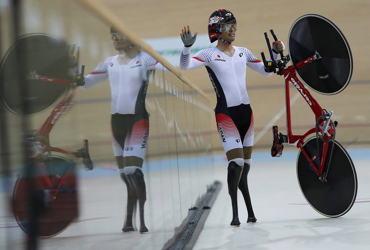 Fujita Masaki of Japan waves after competing in the velodrome.
