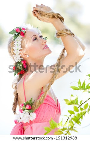 Beautiful Young Woman looking out in Nature with Long hair Braided