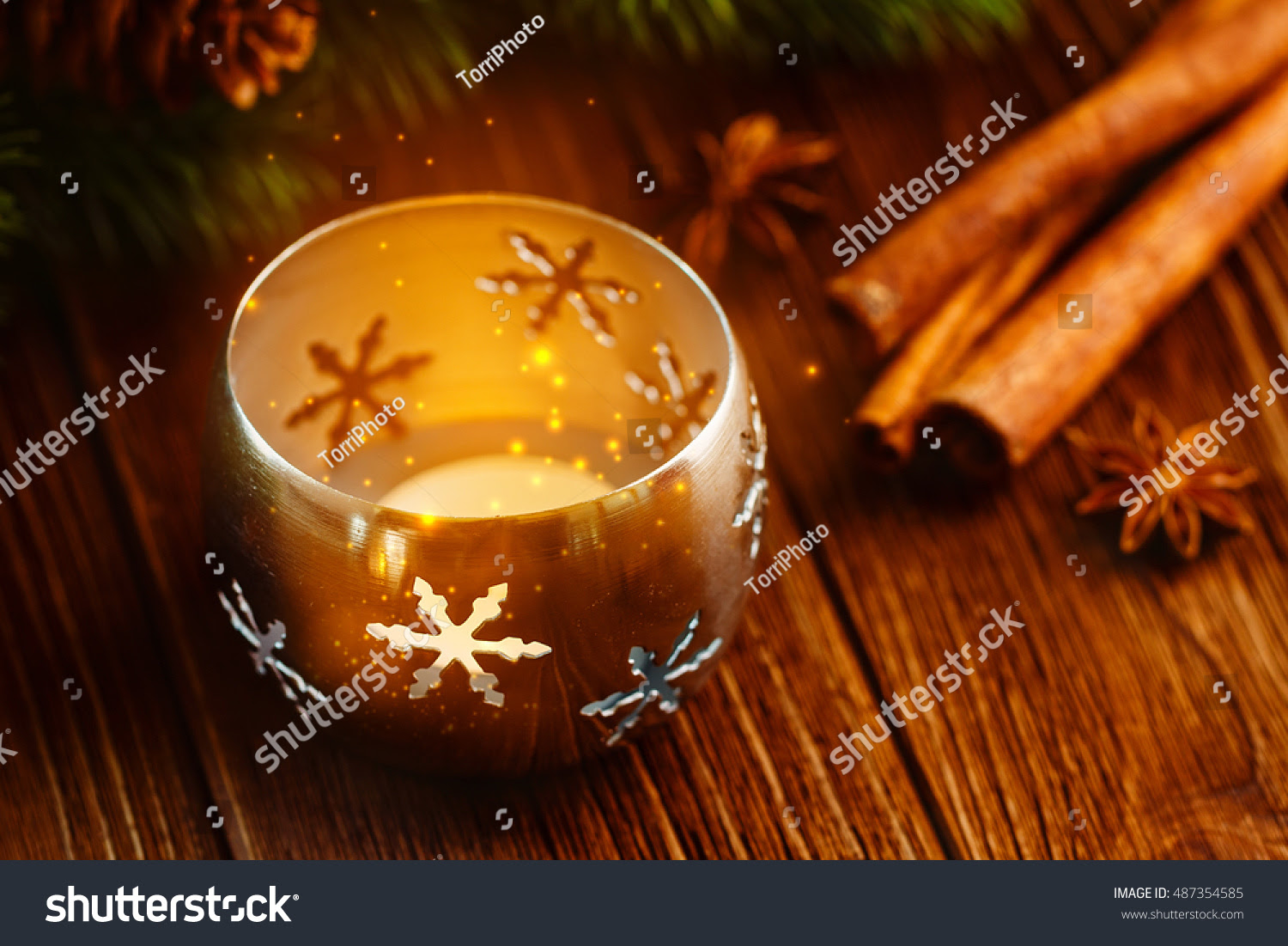 Burning candle lantern with magical shine lights. Rustic Christmas background