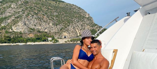 Cristiano Ronaldo embraces his girlfriend,Georgina, in their last appearance in themiddle of the sea ... a photo