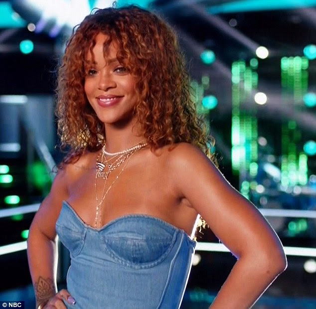 Daring look: The Bajan beauty flashed some flesh as she slipped into a strapless denim crop top and jeans for her special appearance on the show