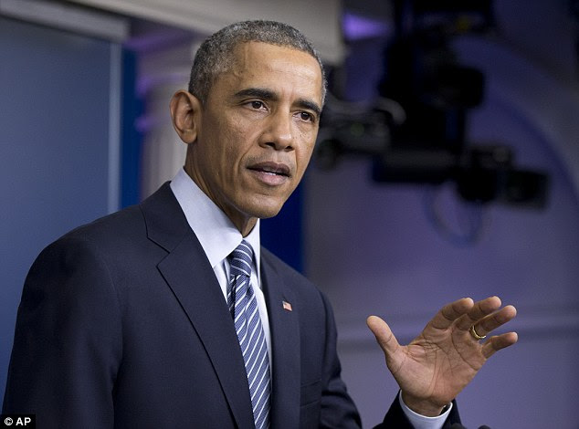 'We need to accept that this decision was the grand jury's to make': Obama counseled acceptance of the outcome in Missouri, even as his Justice Department could lodge federal charges in the case
