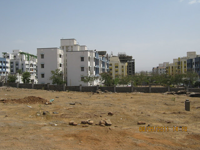 View of RMC Garden and Supreme Aangan from the site office of Karia Developers' Konark Meadows Wagholi on Nagar Road in Pune
