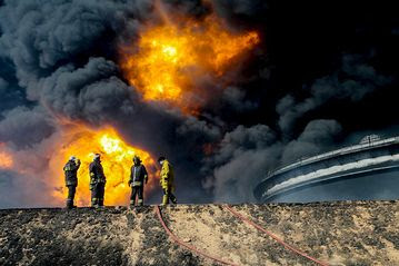 Firefighters battled a blaze at an oil tank in the Libyan port city of Es Sider during a series of attacks last month on the country's oil industry by Islamic State extremists.