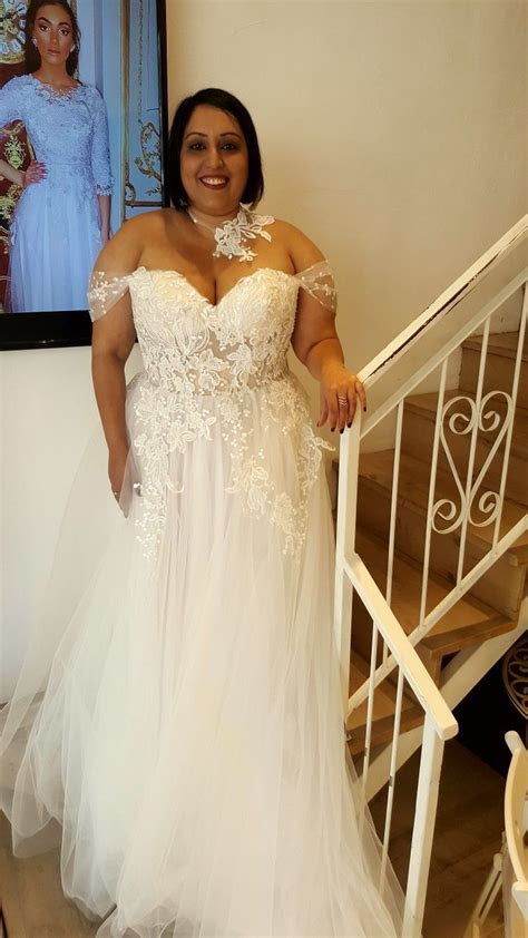 Real plus size bride in a corset strapless ball wedding