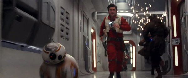 BB-8 and Poe Dameron (Oscar Isaac) scurry down the hallway of a Resistance cruiser in STAR WARS: THE LAST JEDI.