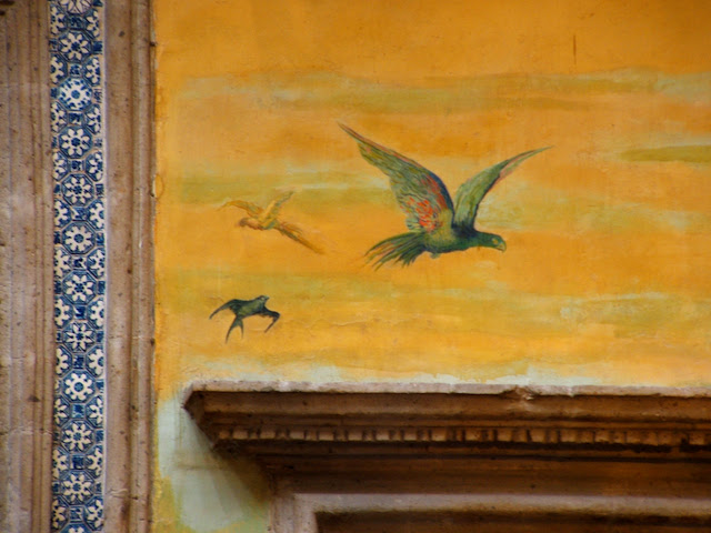 Yellow wall with birds