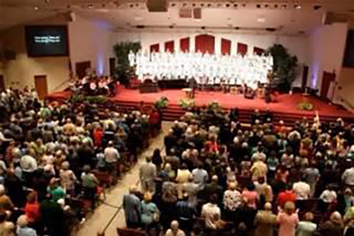 [Photo of a church congregation gathered for worship]