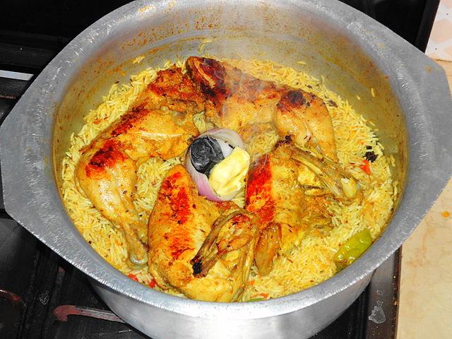 Cuisine of karachi chicken mandi rice national dish of yemen chicken mandi rice during cooking at smoking stage forumfinder Image collections