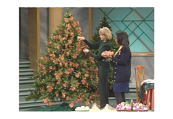 martha stewart decorates a christmas tree with oprah