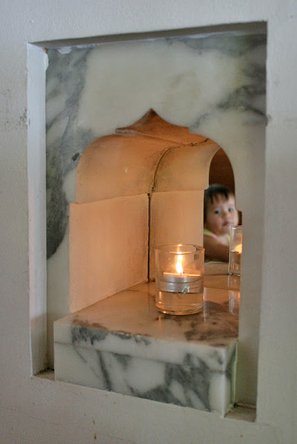 I love the little marble alcoves